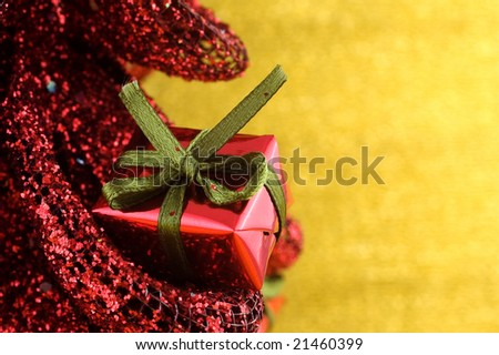 Closeup of a miniature Christmas present with shallow depth of field and copy space