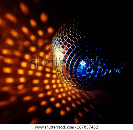 closeup of a mirrorball on a white background  - stock photo