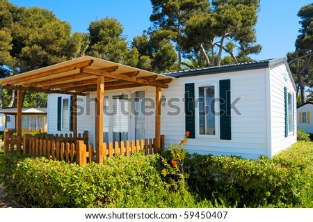 closeup of a mobile home in a campsite on the beach - stock photo