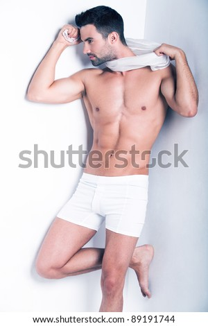 Closeup of a muscular handsome man in underwear