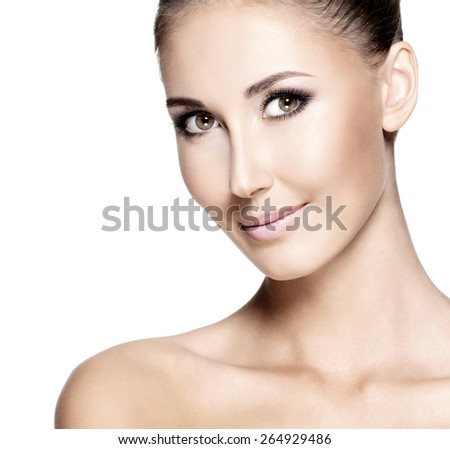Closeup of a natural young woman with perfect skin, isolated on white. - stock photo