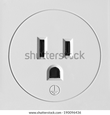 Closeup of a North American 110 volt electrical outlet with ground symbol - stock photo
