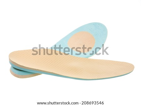 Closeup of a pair of orthopedic shoe insoles - stock photo