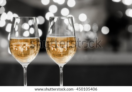 Closeup of a pair of wine glasses. Dining and night life concept.  - stock photo