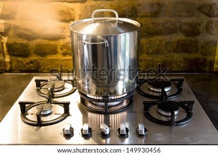 Closeup of a pan on stove - stock photo