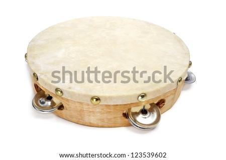 closeup of a pandereta, the spanish tambourine, on a white background - stock photo
