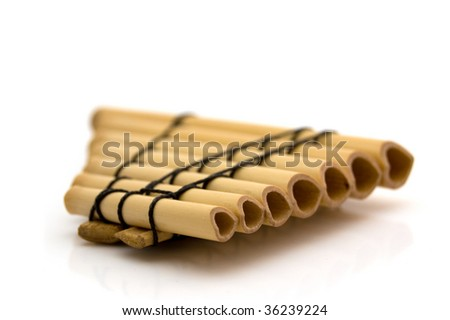 Closeup of a panflute on a white background - stock photo