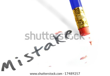 "closeup of a pencil erasing a ""mistake"" - stock photo"