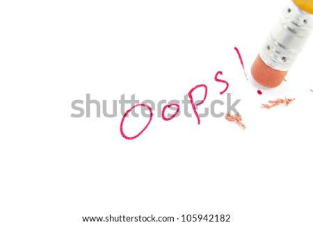 closeup of a pencil erasing an error - stock photo