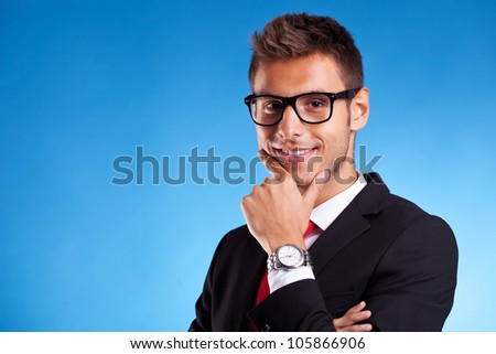 Closeup of a Pensive young business man on blue background - stock photo