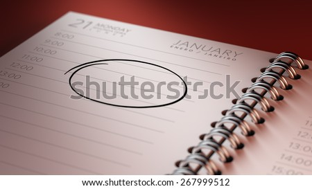 Closeup of a personal agenda, organizer or planner, setting an important date, marking a day of the month representing a organizing time and schedule. - stock photo