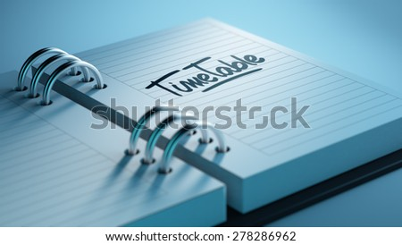 Closeup of a personal agenda setting an important date representing a time schedule. The words Timetable written on a white notebook to remind you an important appointment. - stock photo