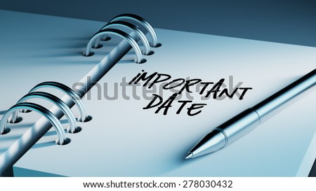 Closeup of a personal agenda setting an important date writing with pen. The words Important date written on a white notebook to remind you an important appointment. - stock photo