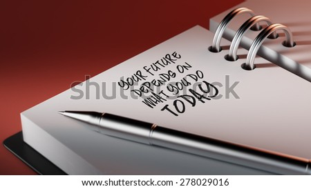 Closeup of a personal agenda setting an important date writing with pen. The words Your future depends on what you do today written on a white notebook to remind you an appointment.