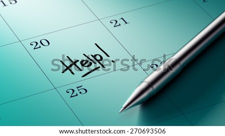 Closeup of a personal agenda setting an important date written with pen. The words Help written on a white notebook to remind you an important appointment.