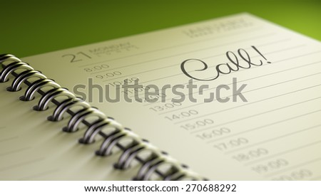 Closeup of a personal calendar setting an important date representing a time schedule. The words Call written on a white notebook to remind you an important appointment.