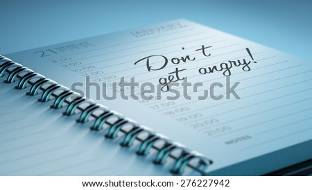 Closeup of a personal calendar setting an important date representing a time schedule. The words Don't get angry written on a white notebook to remind you an important appointment. - stock photo