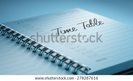 Closeup of a personal calendar setting an important date representing a time schedule. The words Timetable written on a white notebook to remind you an important appointment. - stock photo