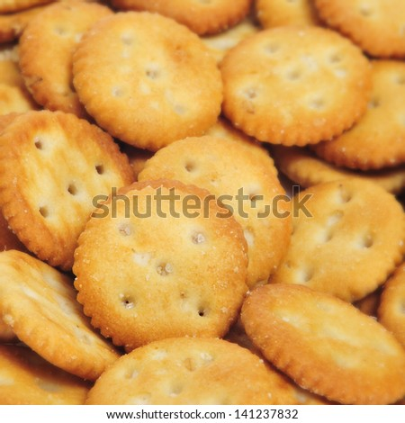 closeup of a pile of appetizing salty round crackers - stock photo