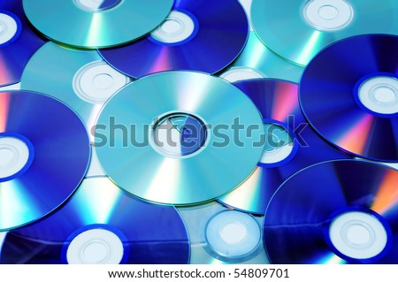 closeup of a pile of CD, CD-ROM and DVD - stock photo