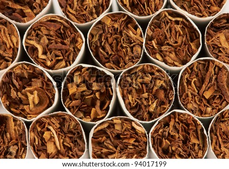 Closeup of a pile of cigarettes - stock photo