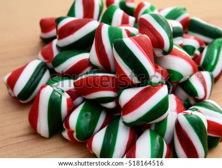 Closeup of a pile of green, red and white peppermint candy