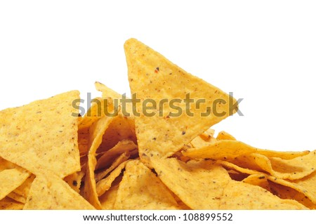 closeup of a pile of nachos on a white background - stock photo