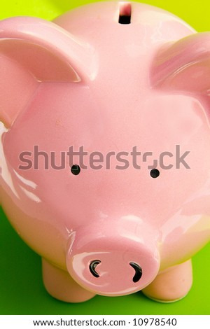 Closeup of a pink piggy bank, on green - stock photo
