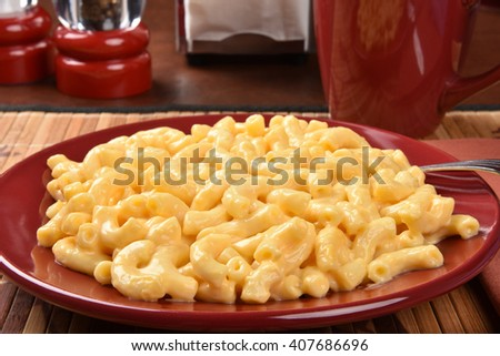 Closeup of a plate of macaroni and cheese  - stock photo