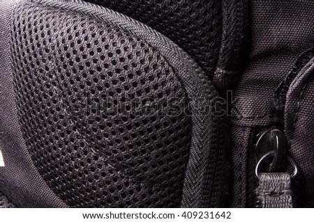 closeup of a pockets in the black photobackpack