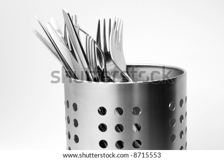 Closeup of a polished steel cutlery in a luxury aluminum stand. - stock photo