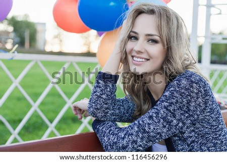 Closeup of a pretty woman in a park against the sunset, outdoors - stock photo
