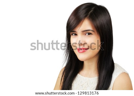 Closeup of a pretty young asian woman with wide smile isolated on white background - copyspace
