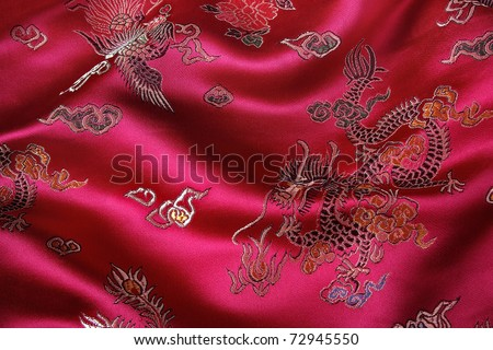 Closeup of a red silky chinese fabric with oriental motifs - stock photo