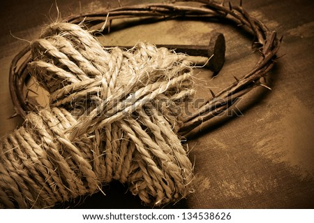 closeup of a representation of the Jesus Christ crown of thorns and nail, and a rope cross - stock photo