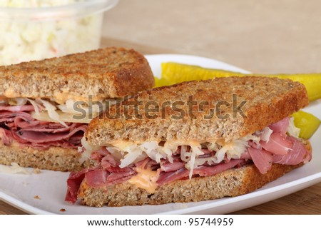 Closeup of a reuben sandwich with pastrami on a plate