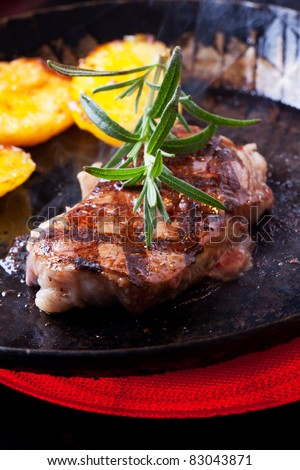 closeup of a rosemary leaf on a steak - stock photo