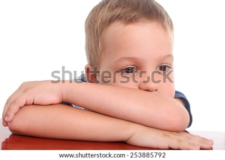 closeup of a sad little boy on a white background - stock photo