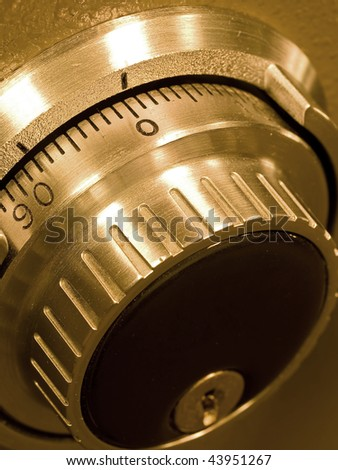 Closeup of a Safe Vault Combination Spinner - Gold Toned - stock photo