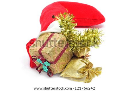 closeup of a santa claus sock full of christmas ornaments on a white background - stock photo