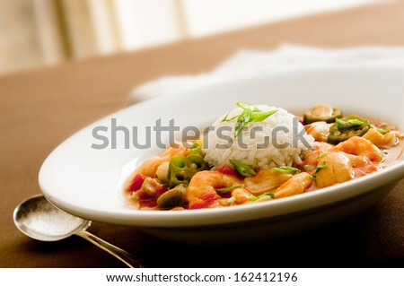Closeup of a seafood gumbo with shrimp, scallops and crab meat - stock photo