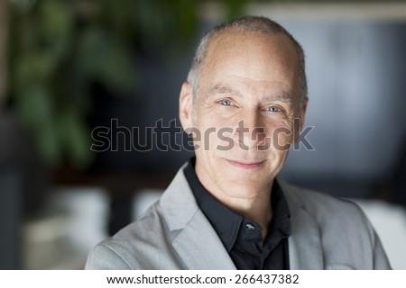 Closeup Of A Senior Man Smiling At The Camera - stock photo
