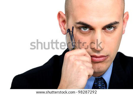 Closeup of a serious man in suit - stock photo