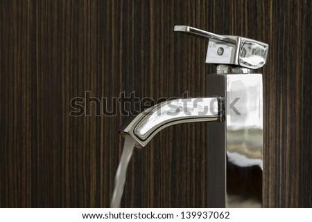 closeup of a shiny silver tap - stock photo