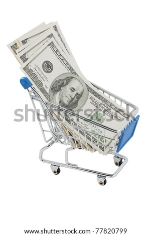 Closeup of a shopping cart full of US dollars (isolated on white) - stock photo