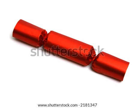 Closeup of a single red Christmas English party cracker isolated over white. Lost of space for your text or design.