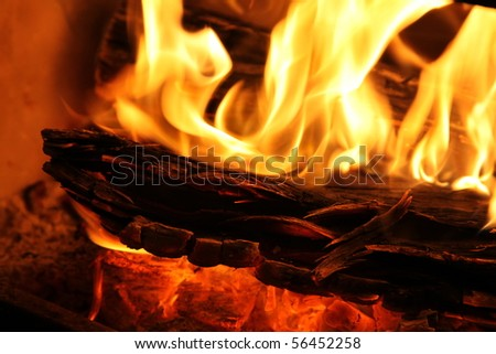 Closeup of a slow combustion wood fire. - stock photo