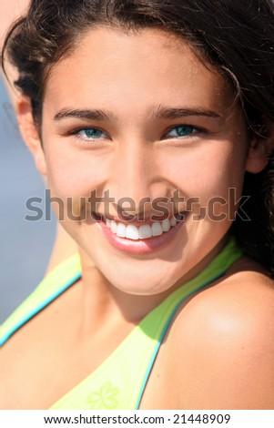 Closeup of a smiling teenage girl - stock photo