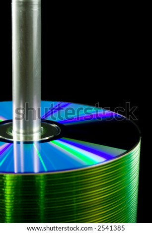 Closeup of a spindle of CDs isolated on white background