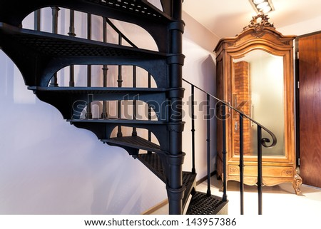 Closeup of a spiral staircase dark metal steps - stock photo